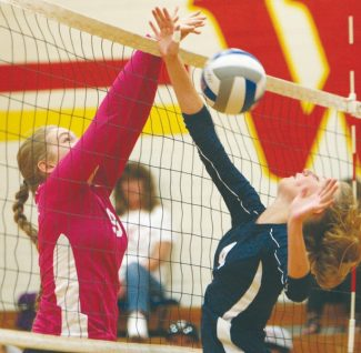 Becky Regan / Tahoe Daily Tribune Middle hitter Zoe Bertz stuffs a hit from North Tahoe in game one of Whittell High School's 3-0 win against the Lakers Wednesday night.