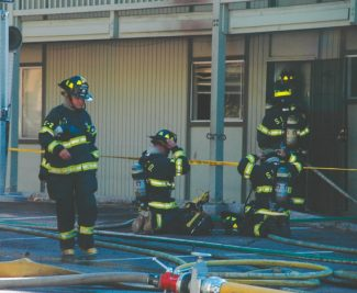 Axie Navas / Tahoe Daily TribuneFirefighters prepare to enter the unit at Forest Manor Apartments where a drug operation caused an explosion around 3:30 p.m. on Wednesday.
