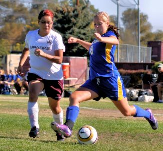 Courtesy of Nick Lee Jordyn Dion legs it out to beat Sparks to the ball Thursday in the girls 4-0 win on the road. Dion has 12 goals and eight assists this season.