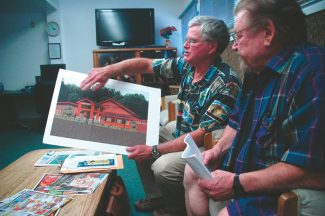 Axie Navas / Tahoe Daily TribuneKenneth Sands, left, and R.S. Lynn point to a $280,000 renovation they planned for the senior center. They haven't moved forward with the plans because they said they're worried El Dorado County will take over more space at the center.