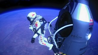 This image provided by Red Bull Stratos shows pilot Felix Baumgartner of Austria as he jumps out of the capsule during the final manned flight for Red Bull Stratos on Sunday, Oct. 14, 2012. In a giant leap from more than 24 miles up, Baumgartner shattered the sound barrier Sunday while making the highest jump ever — a tumbling, death-defying plunge from a balloon to a safe landing in the New Mexico desert. (AP Photo/Red Bull Stratos)