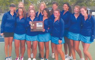 Courtesy of Jenny Clark The South Tahoe tennis girls are all smiles after winning first place in the regional finals Friday in Reno. It was the first time in school history the team took regionals and they now advance to state championships.