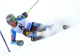 Ted Ligety, of the United States, passes a gate on his way to winning an alpine ski, men's World Cup giant slalom in Soelden, Austria, Sunday, Oct. 28, 2012. (AP Photo/Alessandro Trovati)