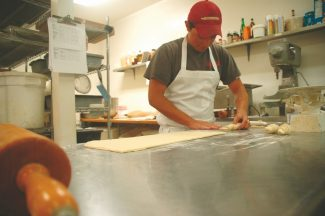 Axie Navas / Tahoe Daily TribuneJonathan Aragon rolls croissants on Wednesday at Sugar Pine Bakery. Aragon and his wife, Teresa, purchased the bakery from previous owners Katie Shultz and Matt Hogan.