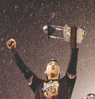 San Francisco Giants' Marco Scutaro celebrates after Game 7 of baseball's National League championship series against the St. Louis Cardinals Monday, Oct. 22, 2012, in San Francisco. The Giants won 9-0 to win the series. Scutaro was named the series MVP. (AP Photo/David J. Phillip)