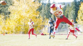 Sylas Wright / Special to the Tribune Alex Barnes flies up in an interception attempt at North Tahoe in Whittell's 36-7 win on the road Saturday.