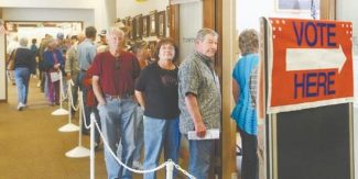 Jim GrantEarly voters line up at the historic Douglas County Courthouse in Minden on Saturday.