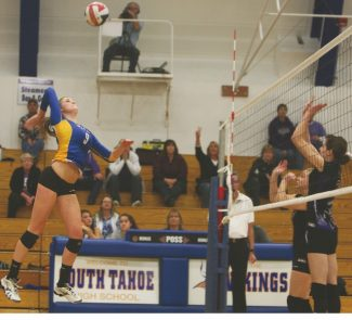 Becky Regan / Tahoe Daily TribuneDrew Norberg flies above the net to slam a kill in Game 2 of South Tahoe's 3-0 win over Spring Creek in the quarterfinals Tuesday.
