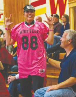 Courtesy of Boyd Dangtondee Kathey Bluethman shows her Warrior pride while she supports the girls volleyball team at the regional quarterfinals Oct. 2 at Whittell High School. Bluethman is wearing a football jersey signed by the team in support of her battle with breast cancer.