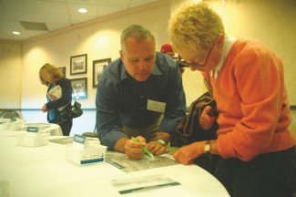 """Axie Navas / Tahoe Daily TribuneMark Rayback with Wood Rodgers explains what the """"Triangle"""" loop road alternative would look like at Wednesday's community workshop."""