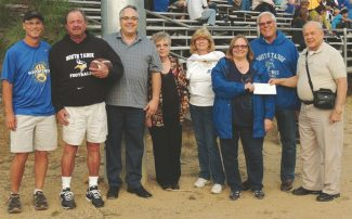 Submitted to the TribuneSTHS Athletic Director Doug Russell, from left, Kiwanis members Mike Gorman, current club President George Alm, Mary Ann Van Buskirk, Cindy Gorman, Principal Ivone Larson, Superintendent James Tarwater, and past club president Dick Van Buskirk are shown.