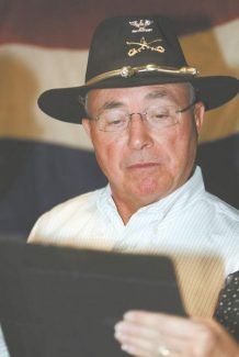 Jim GrantBarry Penzel views early voting results on Tuesday night.