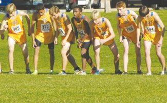Courtesy of Bruce Rettig The boys cross-country team lines up at the starting line, ready to tear up the state championship course Saturday in Boulder City, Nev. The boys claimed third place against five elite running teams from surrounding states.