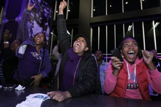 President Barack Obama supporters celebrate televised reports of his projected re-election for president of the United States during a rally at M&T Bank Stadium in Baltimore, Md., Tuesday, Nov. 6, 2012.  (AP Photo/Jose Luis Magana)