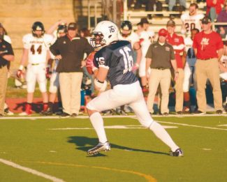 Courtesy of Connie AwreyFormer Viking Willy Ervin loads up for an 18-yard touchdown pass in the final minutes of Marietta College's 38-14 loss Nov. 10.