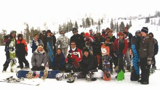 SkiDUCK / Provided to the TribuneA group of SkiDUCKs poses for the camera. The program, which aims to teach underprivileged children how to ski and snowboard, now serves more than 1,000 children nationwide.