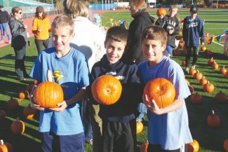 Submitted to the TribuneChristopher Hoefer, Calvin Holmes and Ryan Newberger are shown with their pumpkins during South Tahoe Middle School's pumpkin run.