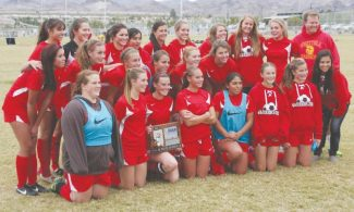 Courtesy of David Heldt-Werle The Whittell High School soccer team poses with its Division III state runner-up plaque after finals against Incline on Saturday in Henderson, Nev.