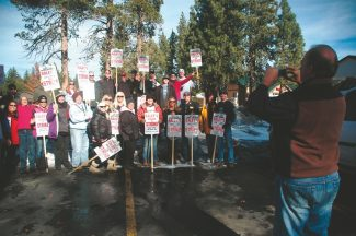 "Axie Navas / Tahoe Daily TribuneRaley's employees, who went on strike on Nov. 4, celebrate the settlement between the unions and the grocery outlet in the Raley's parking lot at the ""Y"" at 10 a.m. on Tuesday."