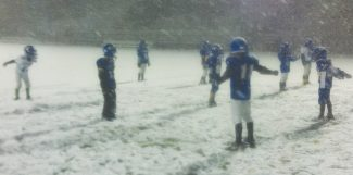 Courtesy of Chris KlugThe South Tahoe Mighty Mites practice in the snow Thursday at South Tahoe High School in preparation for their championship Snow Bowl game today.