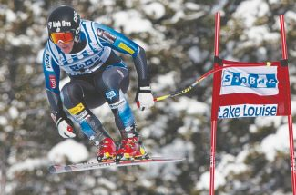Marco Sullivan of the United States speeds down the hill during the men's World Cup downhill ski race in Lake Louise, Alberta, Saturday, Nov. 24, 2012. (AP Photo/The Canadian Press, Jonathan Hayward)