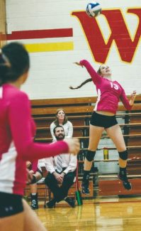 Courtesy of Boyd Dangtongdee  Amanda Harris defies gravity as she loads up for a kill in the Warriors 3-0 win against Silver Stage on Oct. 11. Harris was named Division III MVP.