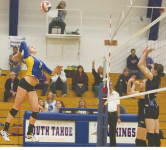Becky Regan / Tahoe Daily TribuneDrew Norberg flies above the net to slam a kill in Game 2 of South Tahoe's win against Spring Creek in regional quarterfinals Oct. 1. Norberg was selected to first team All-State and All-League for her sesaon performance.