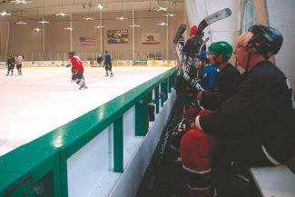 Axie Navas / Tahoe Daily TribunePlayers in a drop-in hockey game Friday watch their team mates at the South Lake Tahoe Ice Arena. The proposed Parks, Trails, and Recreation Master Plan might include a new sports complex on or near the site of the current ice arena and recreation center.