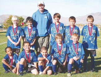 Courtesy of Mark Lehmann South Tahoe's U10 All-Star team proudly displays its medals after an All-Star Tournament in Carson City. Back Row: Jude Stackpole, Lewis Marroquin, Coach Mark Lehmann, Kobe Sitchon, Juliun Lomeli, Leyton Sweeney. Front Row: Miguel Galicia-Sanchez, Diego Rosas, Kevin Vazquez, Marcos Perez-Romero, Andrew Lehmann.