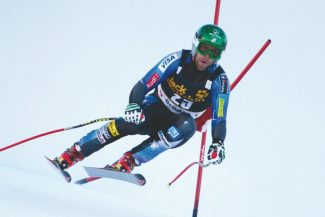 VAL GARDENA, ITALY - DECEMBER 12:  Travis Ganong of USA speeds down the Saslong course whilst taking part in the first official training session for the Audi FIS Alpine Ski World Cup Downhill race on December 12 2012 in Val Gardena, Italy. (Photo by Mitchell Gunn/ESPA) *** Local Caption *** Travis Ganong