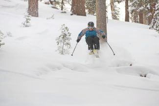 Courtesy of Heavenly A skier takes to the trees for some powder runs at Heavenly on Friday. The recent storms allowed Heavenly to open Mott Canyon on Sunday.
