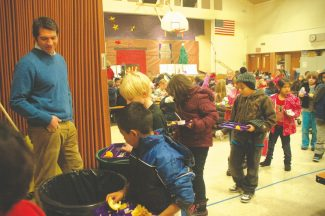 Axie Navas / Tahoe Daily TribuneSierra House Elementary School Principal Ryan Galles instructs students where to dump their food waste, plastics and milk cartons Tuesday in the cafeteria.