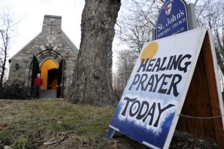 A sign for a Healing Prayer stands outside St. John's Episcopal Church near the scene of a school shooting in Newtown, Conn., Friday, Dec. 14, 2012.  A man opened fire Friday inside two classrooms at the school where his mother worked as a teacher, killing 26 people, including 20 children.  The killer, armed with two handguns, committed suicide at the school and another person was found dead at a second scene, bringing the toll to 28, authorities said. A law enforcement official identified the gunman as 20-year-old Adam Lanza.  (AP Photo/Jessica Hill)