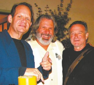 Robin Williams poses at the Throckmorton Theatre in Mill Valley for a Lake Tahoe Action image with professional comedians Bob Zany and Howie Nave.
