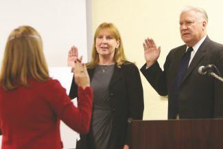 Adam Jensen / Tahoe Daily TribuneSouth Lake Tahoe City Clerk Susan Alessi, left, swears in City Council members JoAnn Conner, middle, and Hal Cole at Lake Tahoe Airport Tuesday morning.