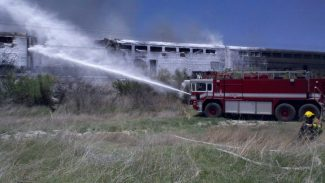 File photoFirefighters from Naval Air Station Fallon and Fallon/Churchill extinguish a fire aboard an Amtrak passenger train June 24, 2011.