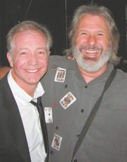 A couple of cards: Ron Morey, left, and Improv host Howie Nave. There is a comedy show every night through Sunday at Harveys, and two on Saturday.
