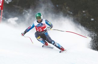 Travis Ganong of the Unitesd States speeds down the course to take the seventh place at an alpine ski, men's World Cup downhill, in Bormio, Italy, Saturday, Dec. 29, 2012. (AP Photo/Alessandro Trovati)