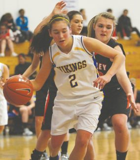 Becky Regan / Tahoe Daily Tribune Brooke King drives toward the hoop Saturday during South Tahoe's win over Fernley at a home crossover game.