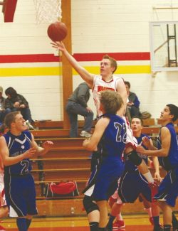 Becky Regan / Tahoe Daily Tribune Garrett Bronken gets the Warriors off to a good start with an explosive opening layup against Smith Valley on Friday at home. The boys won 67-34.
