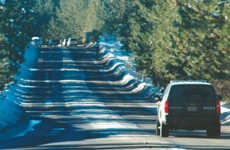 Axie Navas / Tahoe Daily TribuneA police vehicle drives on Pioneer Trail toward the area where Alyssa Byrne's body was discovered Friday morning.