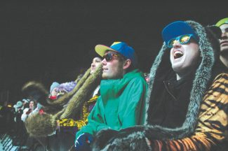 Axie Navas / Tahoe Daily TribuneSnowGlobe concertgoers cheer on Laidback Luke Monday. Many of the fans sported spirit hoods, a type of furry hat that Gaia Licious' Kelly Brosch said was in hot demand.