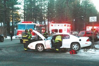 Axie Navas / Tahoe Daily TribuneMedical personnel extricate the female passenger from a white Chevrolet that was struck Friday on Highway 50.