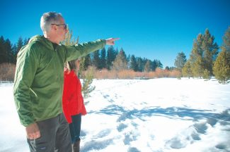 Axie Navas / Tahoe Daily TribuneTyler Cannon points out the future site of a groomed loop on the LTCC Nordic Club course. The center should be open to the public by early February.
