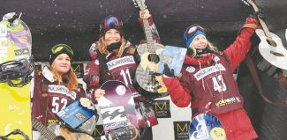 Sarah Brunson / U.S. Snowboarding From left to right: Kjersti Buaas (second place), Jamie Anerson (first), Isabel Derungs (third) hold up some swag after their podium finishes at the women's U.S. Snowboarding Grand Prix slopestyle finals at Copper Mountain last week.