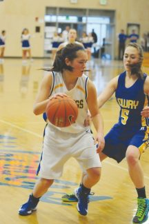 Courtesy of Bob King Ally King maneuvers around Lowry during South Tahoe's home win Saturday.