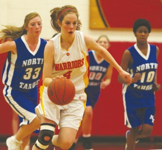 Becky Regan / Tahoe Daily Tribune Emily Harris charges past North Tahoe in the lady Warriors' league win at home Saturday.