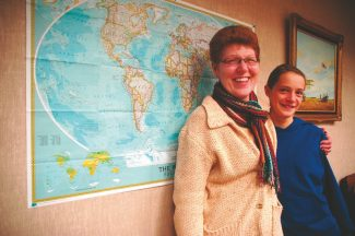 Axie Navas / Tahoe Daily TribuneLynne Brosch and student Jessie Brown pose for a photo in front of a map used for a World Explorers' Club meeting Tuesday.
