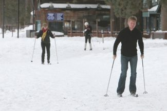 Adam Jensen / Tahoe Daily TribuneWisconsin resident Ron Butkus, front, joins Linda Orillion, left, and Meghan Butkus on a cross-country ski trip at Camp Richardson Wednesday.