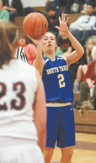 Jim Grant / Nevada Appeal Brooke King lines up her shot in South Tahoe's 48-40 crossover win at Dayton, Tuesday.